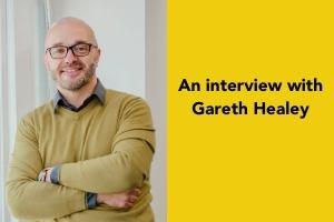 Agency Coach Gareth Healey standing